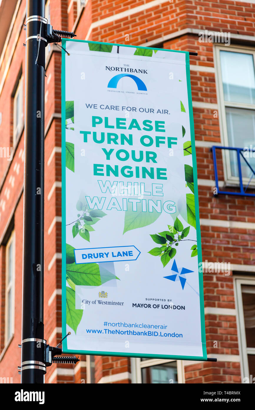 A sign asking vehicle drivers to switch off their engine while waiting to improve air quality, London, England, UK - Stock Image
