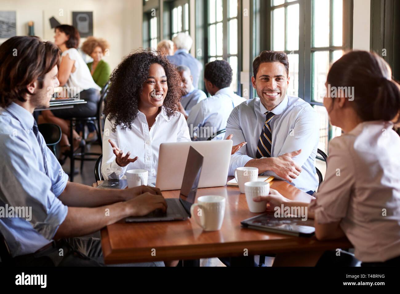 Business Team Having Informal Meeting Around Table In Coffee