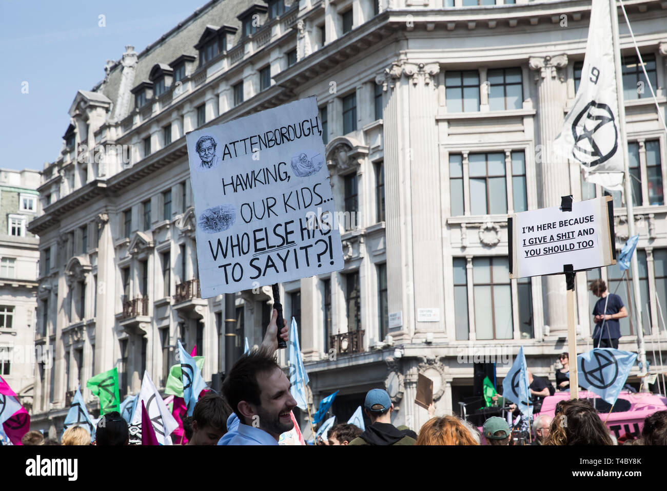 London, UK. 15th Apr, 2019. Climate change protesters In Oxford Circus and Regent street as Environmental protesters paralyse London's roads by creating human barricades at five landmarks. Extinction Rebellion organisers claim 30,000 eco-protesters are expected to block major routes today. They also pulled a boat up Regent Street to highlight the threat of Global Warming, but on a darker side they smashed windows at Shells headquarters. Credit: Keith Larby/Alamy Live News Stock Photo