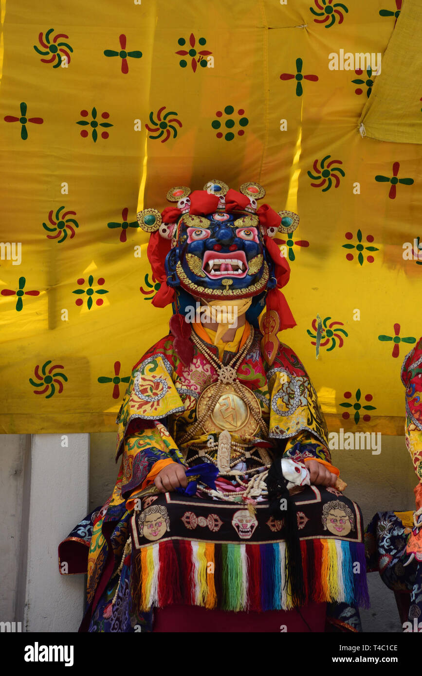 April 14, 2019 - Dali, Darjeeling, West Bengal, India - Tshechu an annual religious Buddhist festival celebrated by the Drukpa Lineage of the Kagyu school of Tibetan Buddhism on tenth day of a month of the Tibetan lunar calendar corresponding to the birthday of Guru Rimpoche (Guru Padmasambhava) was held at Druk Sang-Ngag Choling Monastery in Dali, Darjeeling on 14/04/2019. However the exact month of the Tshechu varies from place to place and Monastery to Monastery. Tshechus are grand events where entire communities come together to witness Cham (mask dances) Performance of Eight Manifestation - Stock Image