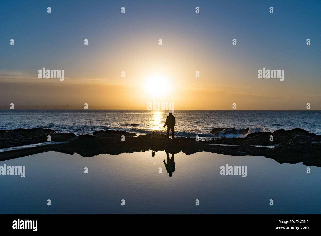Mousehole, Cornwall, UK. 16th Apr, 2019. UK Weather. After 3 days of gale force winds and heavy rain, the weather has swung round this morning ahead of the Easter weekend. It was calm and mild at sunrise with the promise of a hot day ahead. Credit: Simon Maycock/Alamy Live News - Stock Image