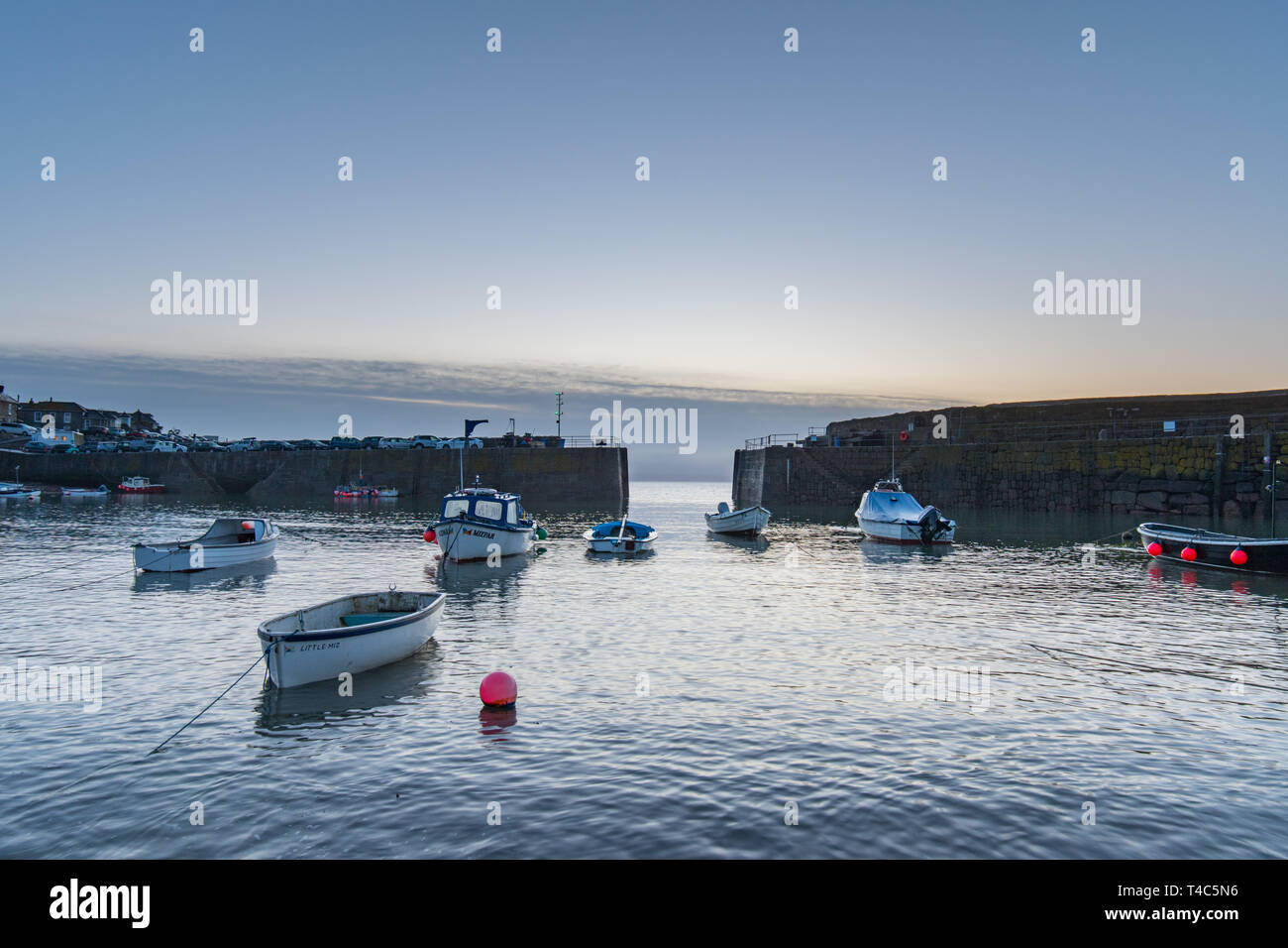 Mousehole, Cornwall, UK. 16th Apr, 2019. UK Weather. After 3 days of gale force winds and heavy rain, the weather has swung round this morning ahead of the Easter weekend. It was calm and mild at sunrise with the promise of a hot day ahead. Credit: Simon Maycock/Alamy Live News Stock Photo