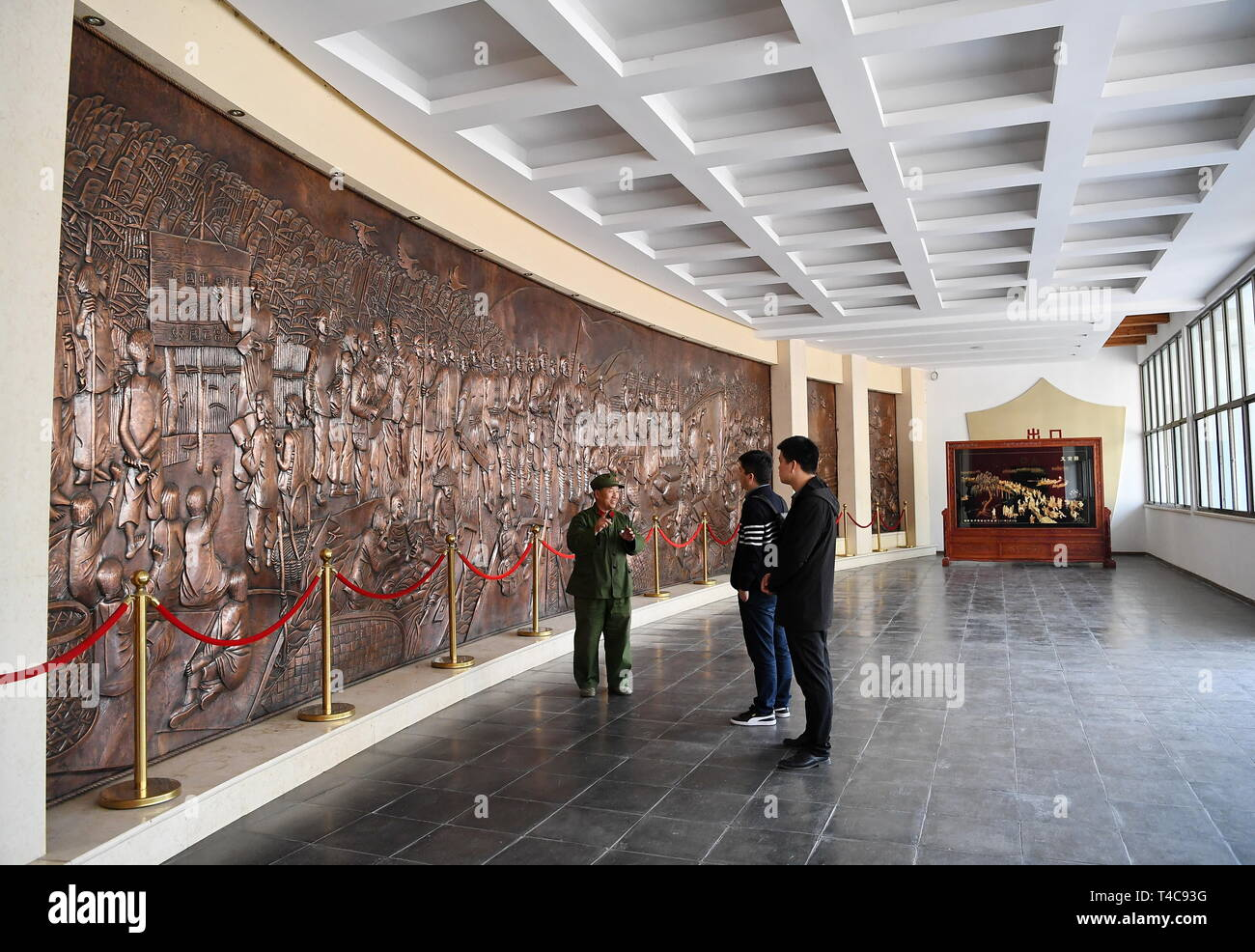 Shijiazhuang, China's Hebei Province. 10th Apr, 2019. Wang Mutou (1st, L) interprets at Baiyangdian memorial hall of anti-Japanese war in Xiongan New Area, north China's Hebei Province, April 10, 2019. Restoration work has started in Baiyangdian Lake, northern China's largest freshwater body. High-pollution and energy-intensive production has been tackled. As a result, water quality has improved remarkably. Credit: Mu Yu/Xinhua/Alamy Live News - Stock Image