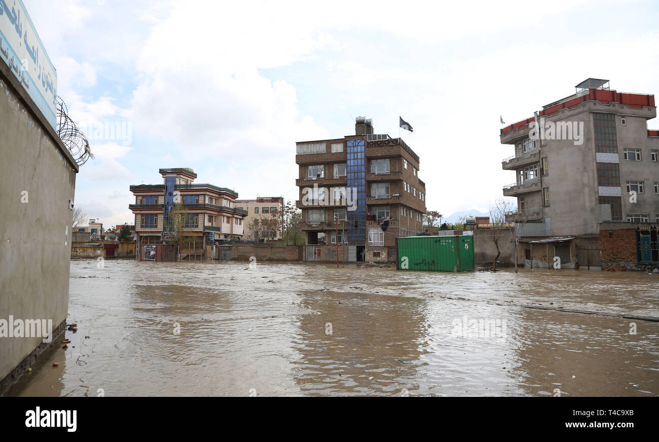 Kabul, Afghanistan. 16th Apr, 2019. Photo taken on April 16, 2019 shows buildings surrounded by flood in Kabul, capital of Afghanistan. One person has been reported dead after the Kabul river flooded in the country's capital, where the government issued a warning asking people to leave flood-prone areas and houses located at the two banks of the river, as the rising overflow was uncontrollable. Credit: Rahmat Alizadah/Xinhua/Alamy Live News - Stock Image