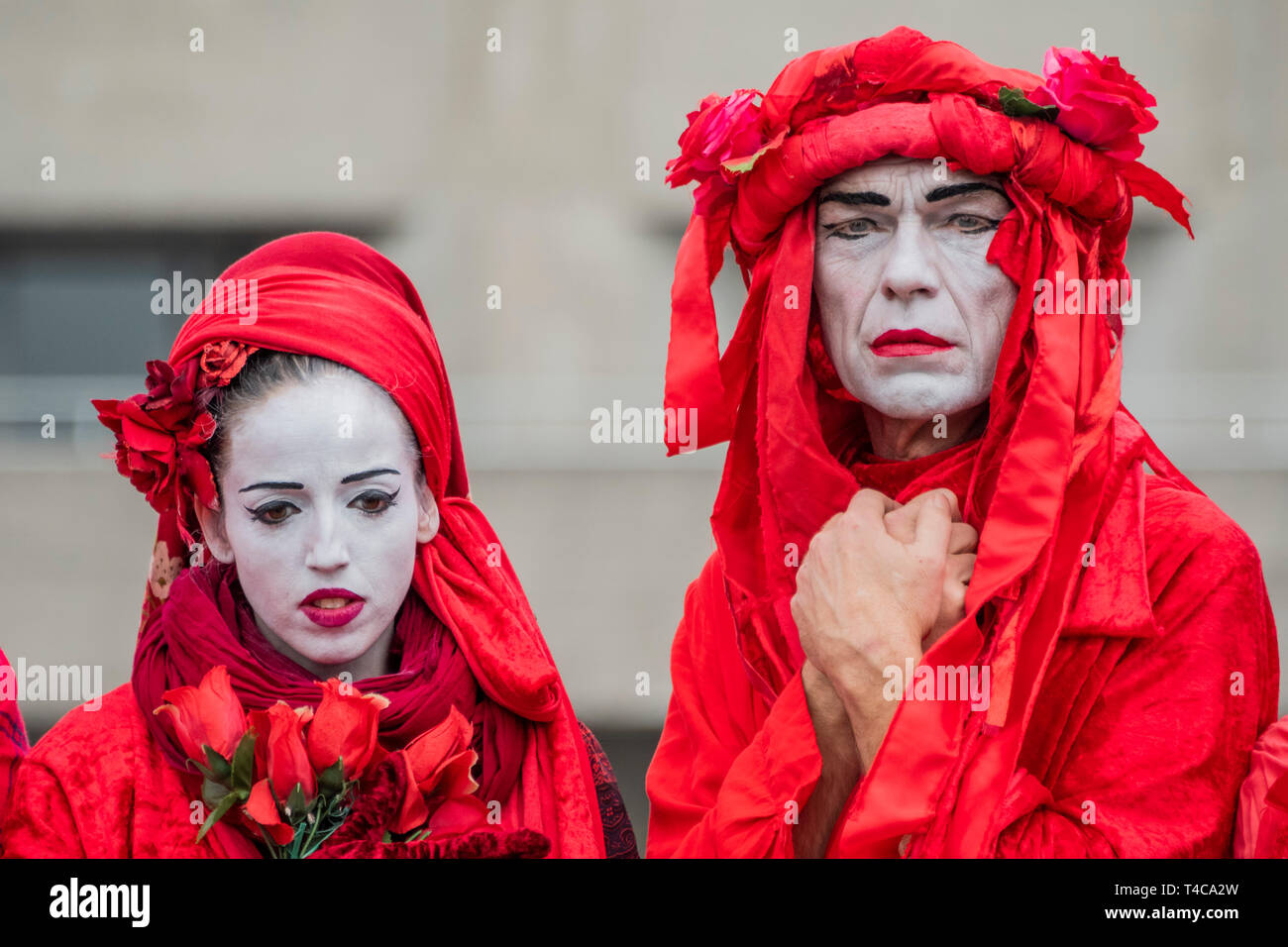 London, UK. 16th Apr, 2019. Performance artists, on Waterloo Bridge, represent the blood of all the species which will become exctinct, including possibly humans -  Day 2 - Protestors from Extinction Rebellion block several (Hyde Park, Oxford Cuircus, Warterloo Bridge and Parliament Square) junctions in London as part of their ongoing protest to demand action by the UK Government on the 'climate chrisis'. The action is part of an international co-ordinated protest. Credit: Guy Bell/Alamy Live News Stock Photo