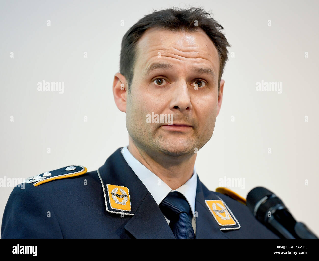 Berlin, Germany. 16th Apr, 2019. Stefan Schipke, commander of the flying group of the Flugbereitschaft BMVg (Air Force), speaks at a press conference about the emergency landing of a Global 5000 of the Flugbereitschaft. The crew survived the incident without any physical damage, Schipke said at the airport. Two pilots and a flight attendant had been on board. Credit: Britta Pedersen/dpa-Zentralbild/dpa/Alamy Live News - Stock Image