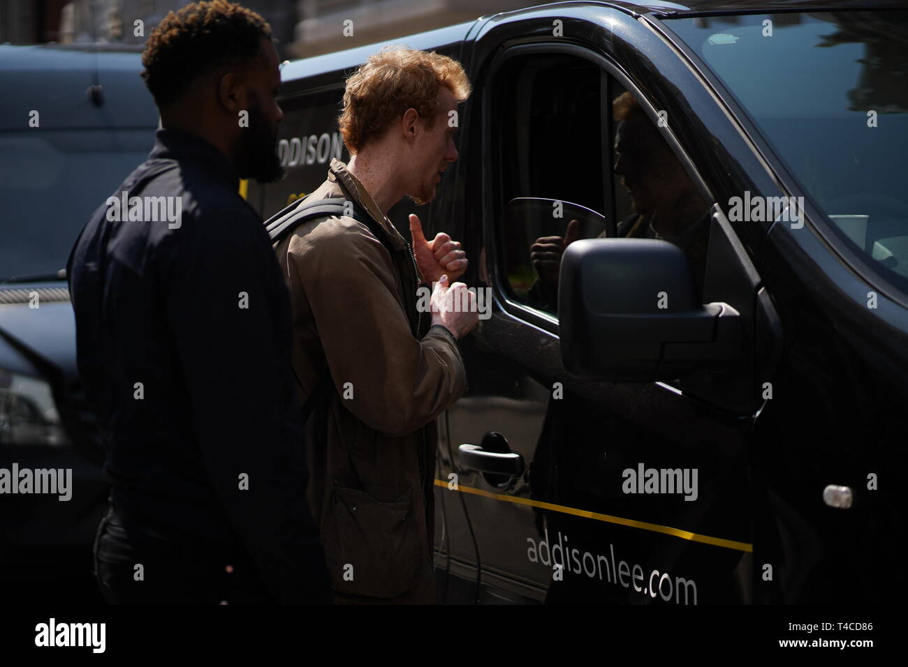 Extinction Rebellion protestors explain to drivers why they are blocking the roads in Central London. Stock Photo