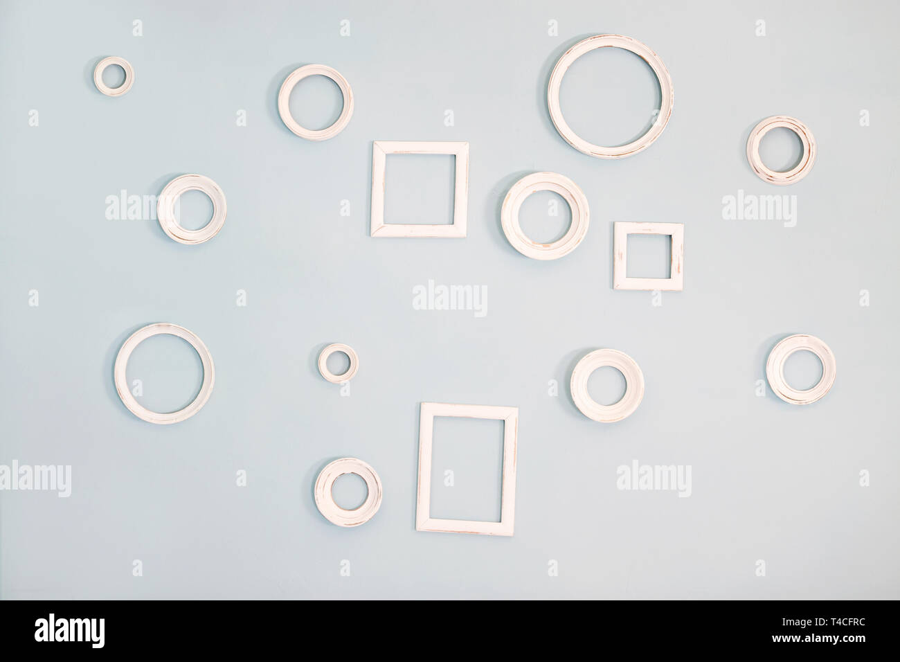 empty picture frames on the blue wall - Stock Image