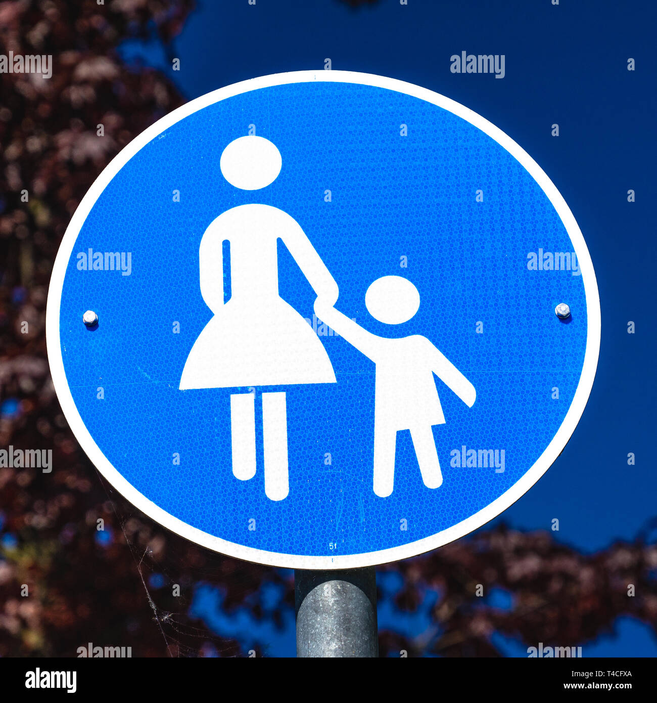 Information sign for a footpath for pedestrians only, symbolized by a figure with skirt and a child figure, not gender correct, Germany Stock Photo