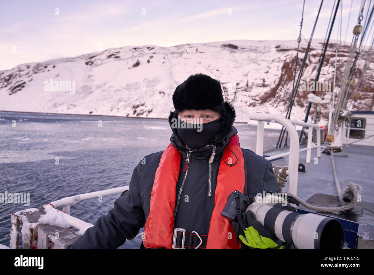 Photographer on the Rembrant Van Rijn, Schooner Ship, Scoresbysund, Greenland - Stock Image
