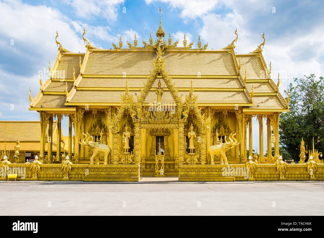 Architecture beautiful temple all gold color with blue sky at bangkla,wat paknam joelo,chachoengsao,thailand - Stock Image