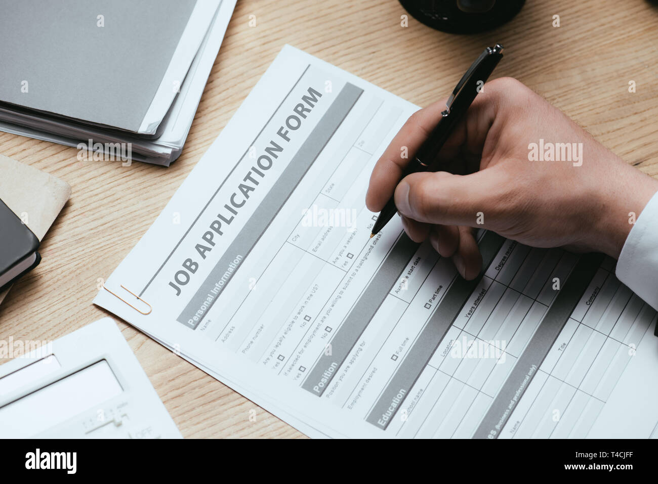 cropped view of man filling in Job Application Form Employment Career Concept Stock Photo