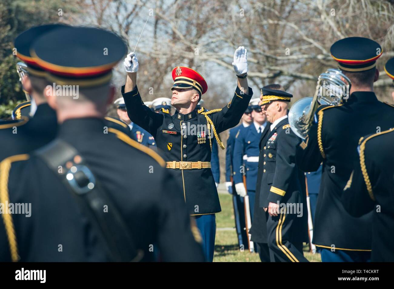"""U.S. Soldiers assigned to the U.S. Army Band """"Pershing's Own"""" perform in an Armed Forces Full Honor Wreath-laying ceremony in honor of the President of Brazil Jair Bolsonaro at Arlington National Cemetery, Arlington, Va., March 19, 2019. The event was hosted by U.S. Army Maj. Gen. Joeseph R. Calloway, Director of Personnel Management Office of the Deputy Chief of Staff-G1. - Stock Image"""