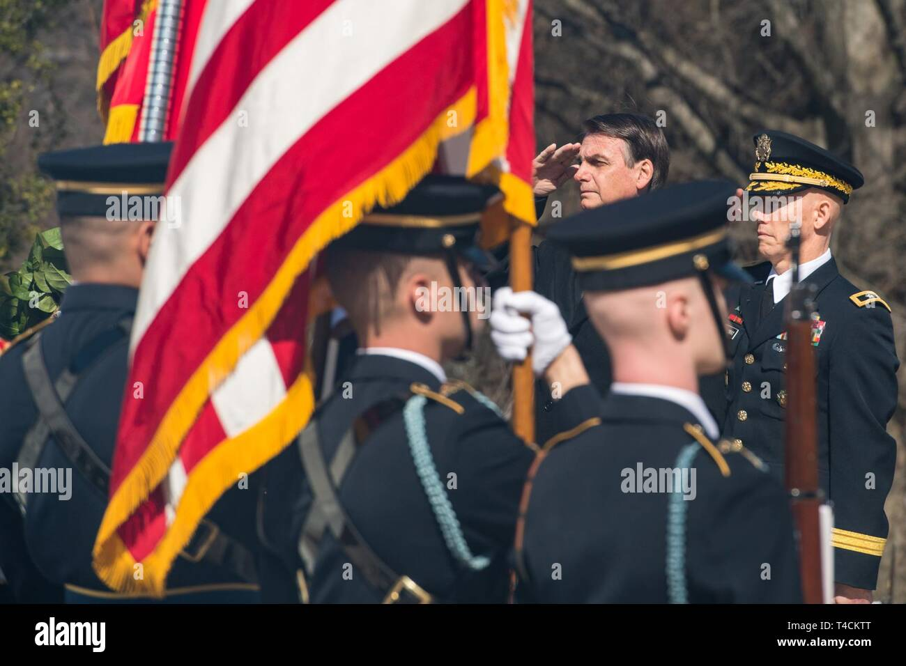U.S. Army Maj. Gen. Joeseph R. Calloway, Director of Personnel Management Office of the Deputy Chief of Staff-G1, hosts an Armed Forces Full Honor Wreath-laying ceremony in honor of the President of Brazil, Jair Bolsonaro at Arlington National Cemetery, Arlington, Va., March 19, 2019. - Stock Image