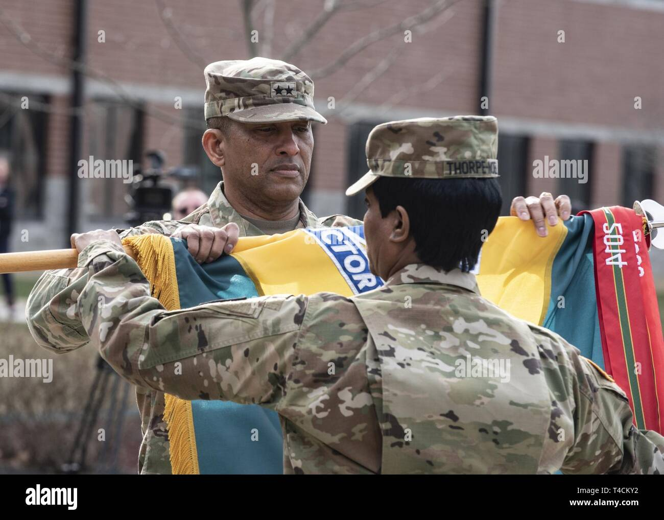 Maj. Gen. Jason T. Evans, U.S. Army Human Resources Command commanding general, furls the HRC unit colors during a repatching ceremony held at the Lt. Gen. Timothy J. Maude complex located on Fort Knox, Ky., March 20, 2019. Nearly 18 months prior, the Army designated HRC as a direct reporting unit to HQDA G1. As a DRU, HRC provides the distribution and strategic talent management of active and reserve component Soldiers and executes personnel-related programs and services Army-wide to ensure readiness and strengthen an agile and adaptive Army. - Stock Image