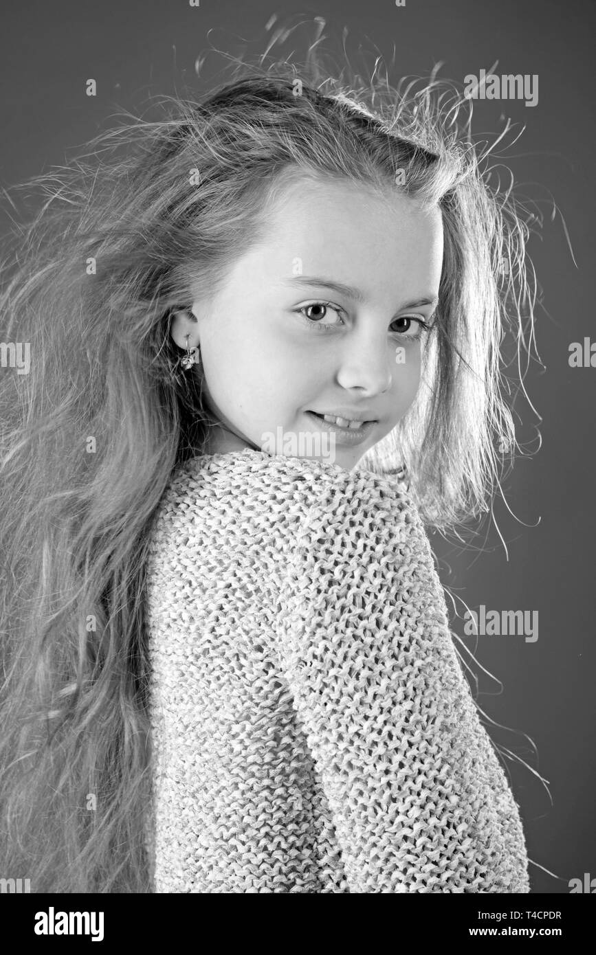 kid hairdresser. Skin and hair care. childhood of happy kid. Fashion portrait of little girl. beauty. small girl with long hair. Young expertise - Stock Image