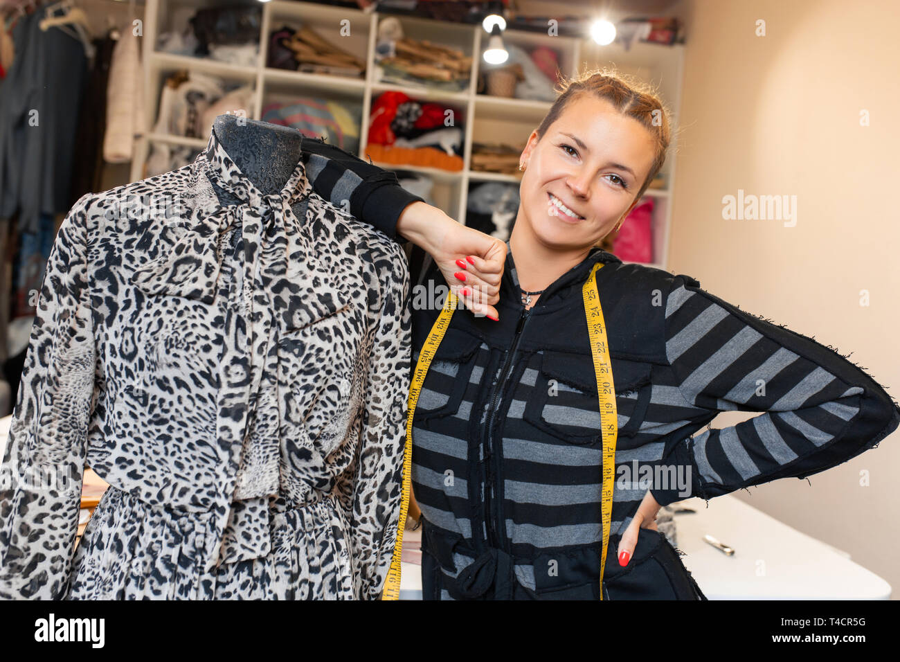 Dressmaker With Mannequin As Professional Fashion Designer Female Dressmaker Adjusting Clothes On Tailoring Mannequin And Smiling Stock Photo Alamy