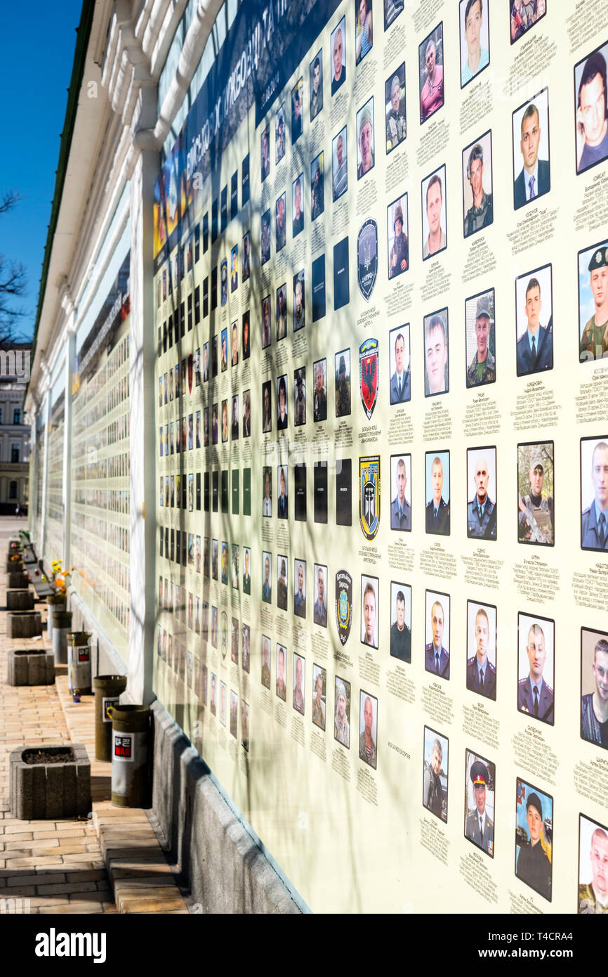 War in Donbass: names and pictures of soldiers killed in the pro-Russian uprest in the Donbass region are displayed on the outside walls of Saint Mich Stock Photo