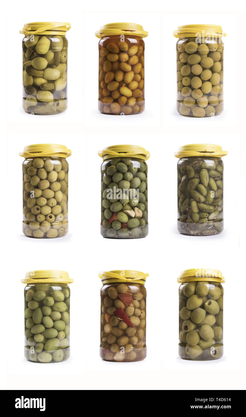 compilation of plastic carafes of pickles isolated on white background: variety of mediterranean olives - Stock Image