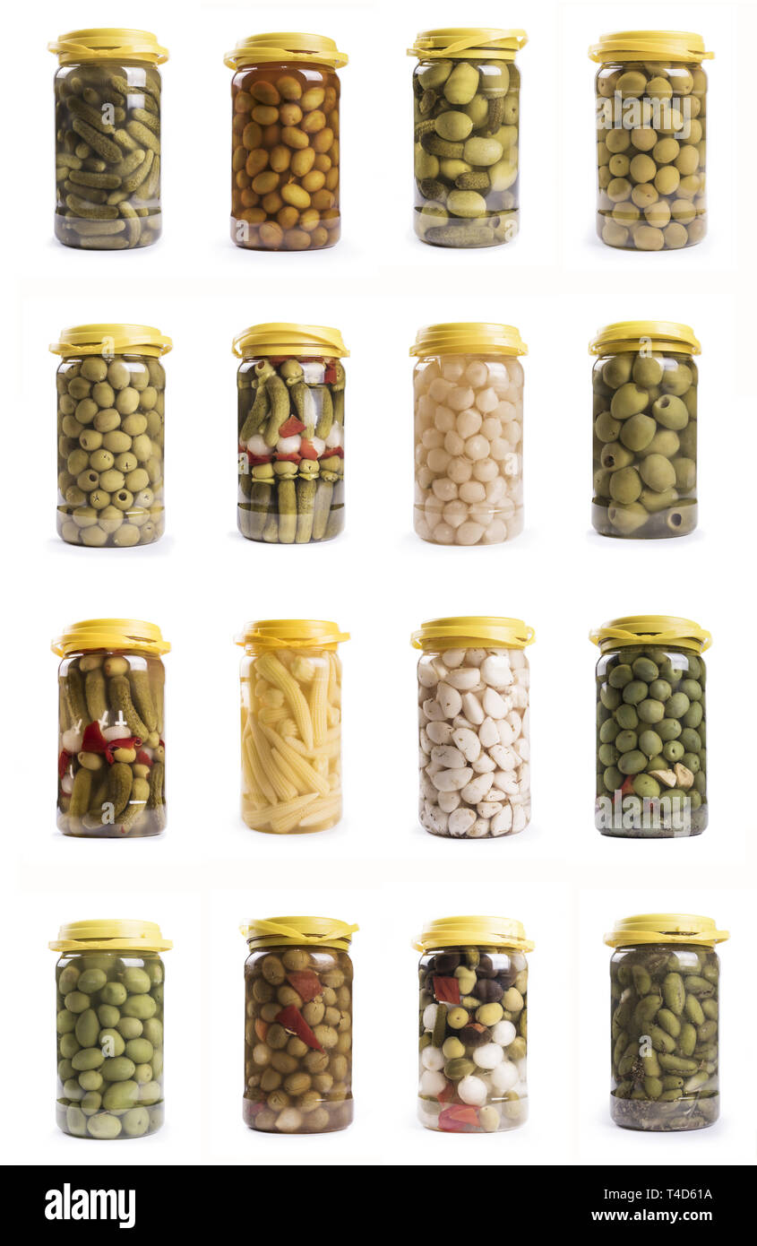 compilation of plastic carafes of pickles isolated on white background: olives and vinegar products - Stock Image