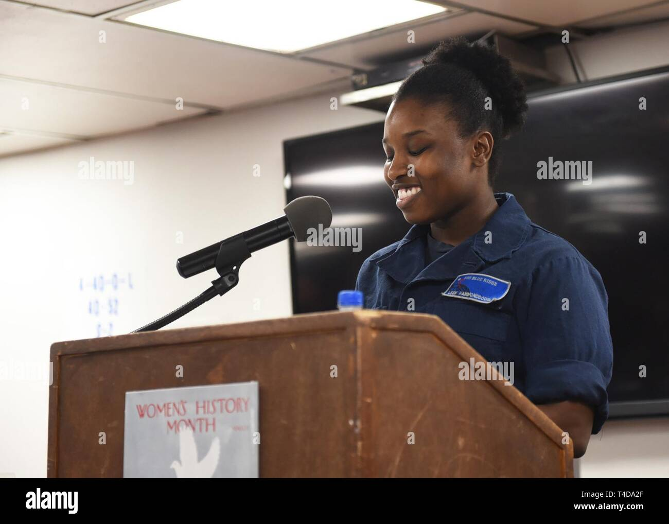 SOUTH CHINA SEA (March 22, 2019) - Logistics Specialist Seaman Zikeya Hammond-Douglas, from Philadelphia, speaks during a Women's History Month celebration on the mess decks of U.S. 7th Fleet Flagship USS Blue Ridge (LCC 19). Blue Ridge is the oldest operational ship in the Navy and, as 7th Fleet command ship, actively works to foster relationships with allies and partners in the Indo-Pacific Region. - Stock Image