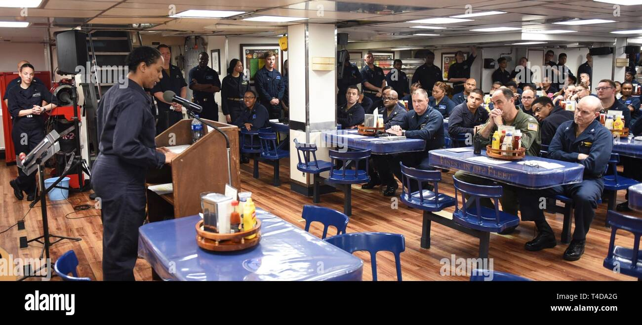 SOUTH CHINA SEA (March 22, 2019) - Operations Specialist 1st Class Latrisha Nash, from Union, S.C., speaks during a Women's History Month celebration on the mess decks of U.S. 7th Fleet Flagship USS Blue Ridge (LCC 19). Blue Ridge is the oldest operational ship in the Navy and, as 7th Fleet command ship, actively works to foster relationships with allies and partners in the Indo-Pacific Region. - Stock Image