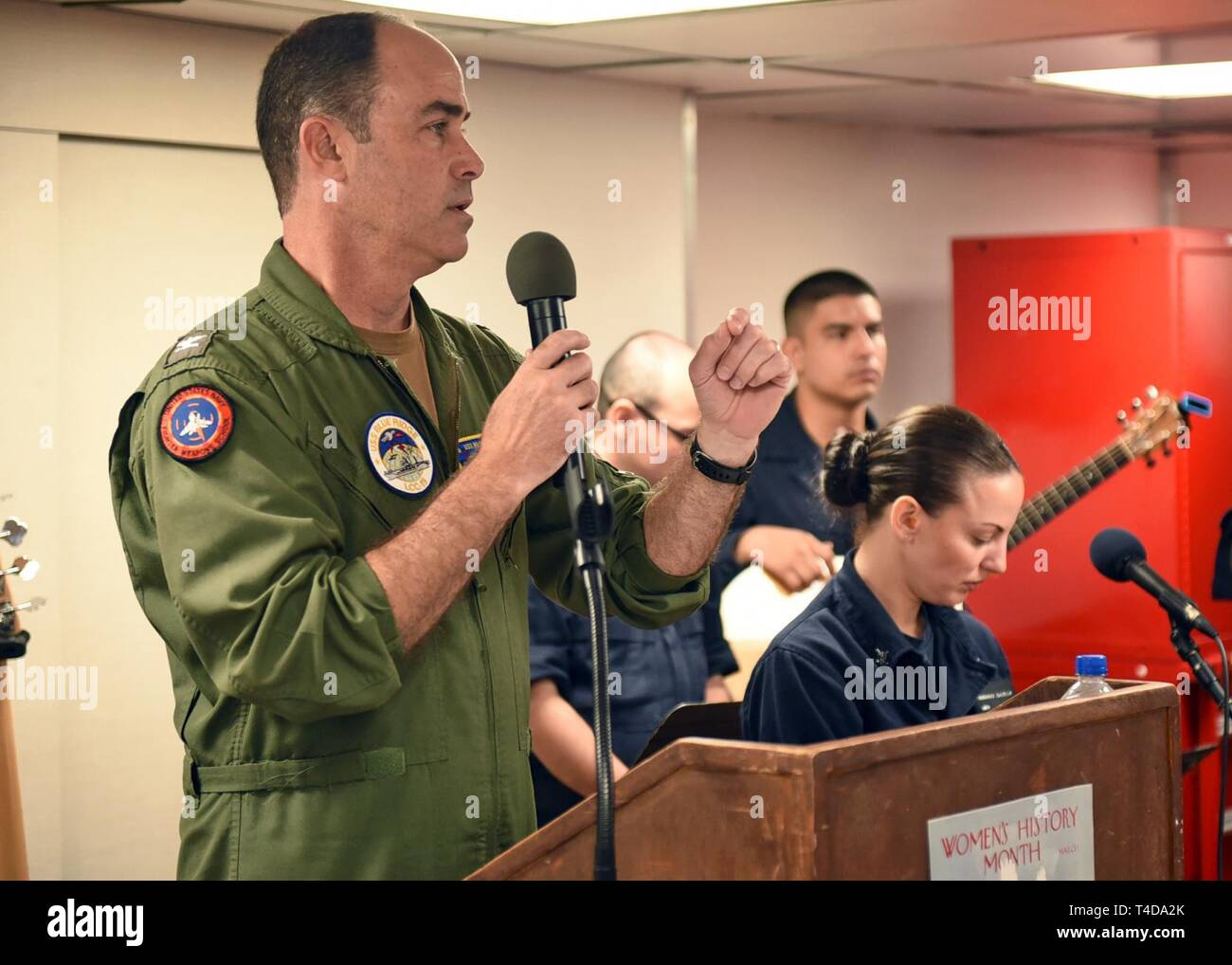 SOUTH CHINA SEA (March 22, 2019) - Capt. Eric J. Anduze, commanding officer of U.S. 7th Fleet Flagship USS Blue Ridge (LCC 19), speaks during a Women's History Month celebration on the ship's mess decks. Blue Ridge is the oldest operational ship in the Navy and, as 7th Fleet command ship, actively works to foster relationships with allies and partners in the Indo-Pacific Region. - Stock Image