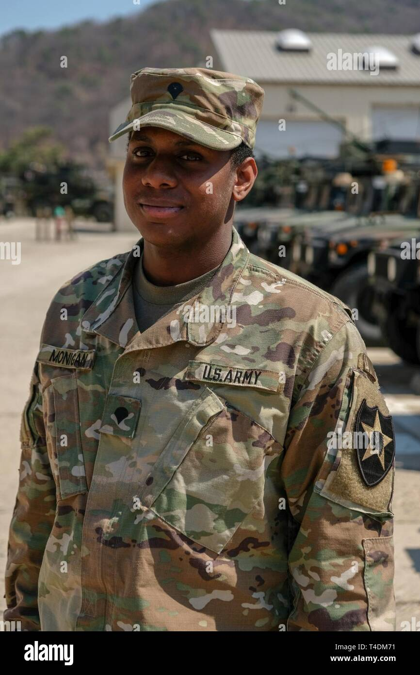 Spc. Deonte Monigan, signal support systems specialist, native of Columbia, S.C., assigned to Headquarters and Headquarters Battery, 210th Field Artillery Brigade, stands for a photo and explains why he serves in the U.S. Army, April 2, 2019, Camp Casey, Republic of Korea. Monigan's parents both served as human resources specialists, which is how they met. Monigan's mother, Capt. Karen Monigan, is currently a human resources officer at Joint Base Lewis-McChord, and his father retired as a 1st Sgt. in the adjutant general corps. Spc. Monigan grew up in the Army. 'I joined for better opportuniti - Stock Image