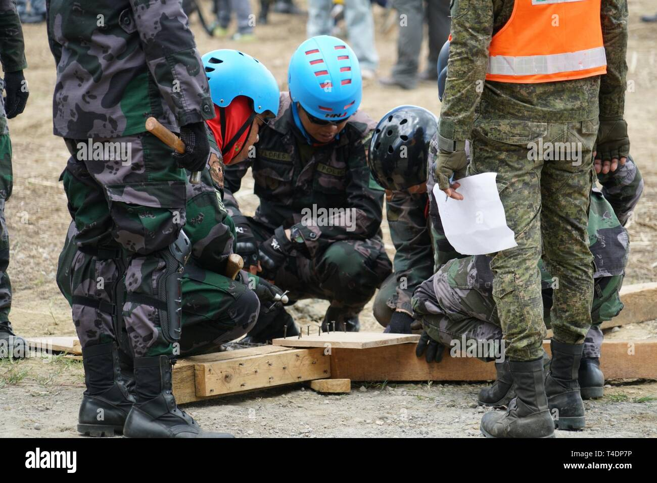 Rescue workers from the Tacloban Police Department construct a collapsed structure shoring system during the Pacific Partnership 2019 Humanitarian Assistance and Disaster Relief (HADR) exercise in Tacloban, Philippines, March 21, 2019. Pacific Partnership's mission is to work collectively with host and partner nations to enhance regional interoperability and disaster response capabilities, increase stability and security in the region, and foster new and enduring friendships across the Indo-Pacific region.  Pacific Partnership, now in its 14th iteration, is the largest annual multinational hum - Stock Image