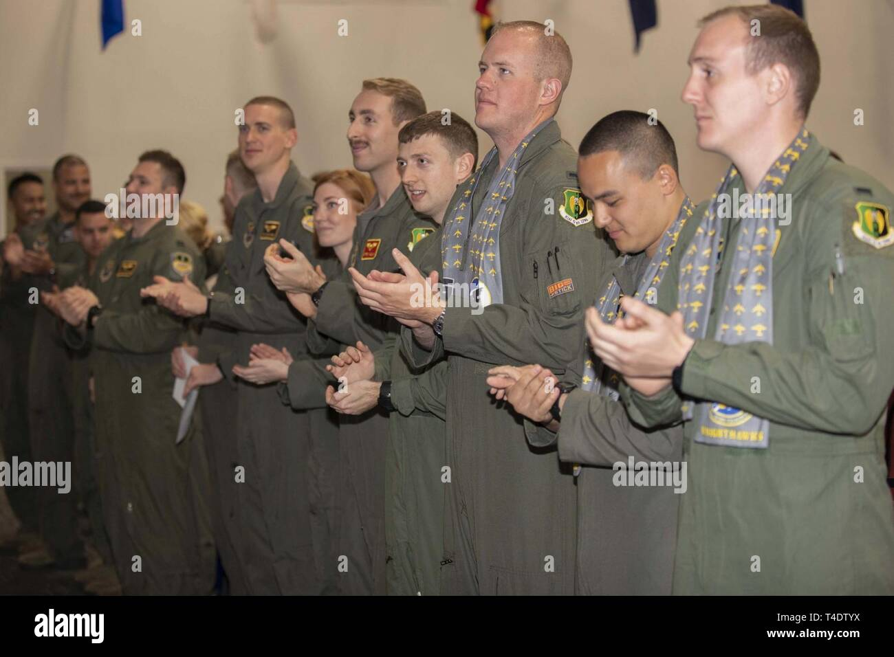 Members of Formal Training Unit Class 18-02 applaud at the end of