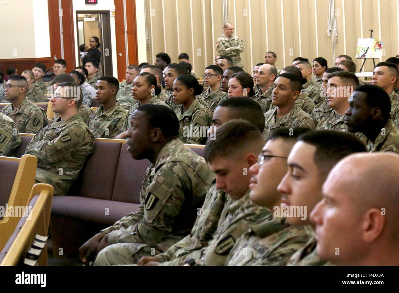 1st Signal Brigade, Eighth Army Soldiers listen to a speech on women's history March 25, 2019, Freedom Chapel, Camp Humphreys, Republic of Korea. The theme of the 2019 Women's History Month is Visionary Women: Champions of Peace & Nonviolence. - Stock Image