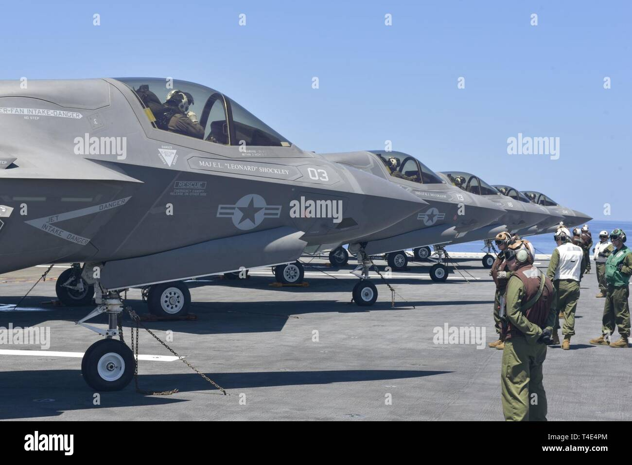 SOUTH CHINA SEA (March 29, 2019) -  Sailors and Marines prepare F-35B Lightning II aircraft assigned to Marine Fighter Attack Squadron (VMFA) 121 for flight operations aboard the amphibious assault ship USS Wasp (LHD 1). Wasp, flagship of Wasp Amphibious Ready Group, is operating in the Indo-Pacific region to enhance interoperability with partners and serve as a lethal, ready-response force for any type of contingency. - Stock Image