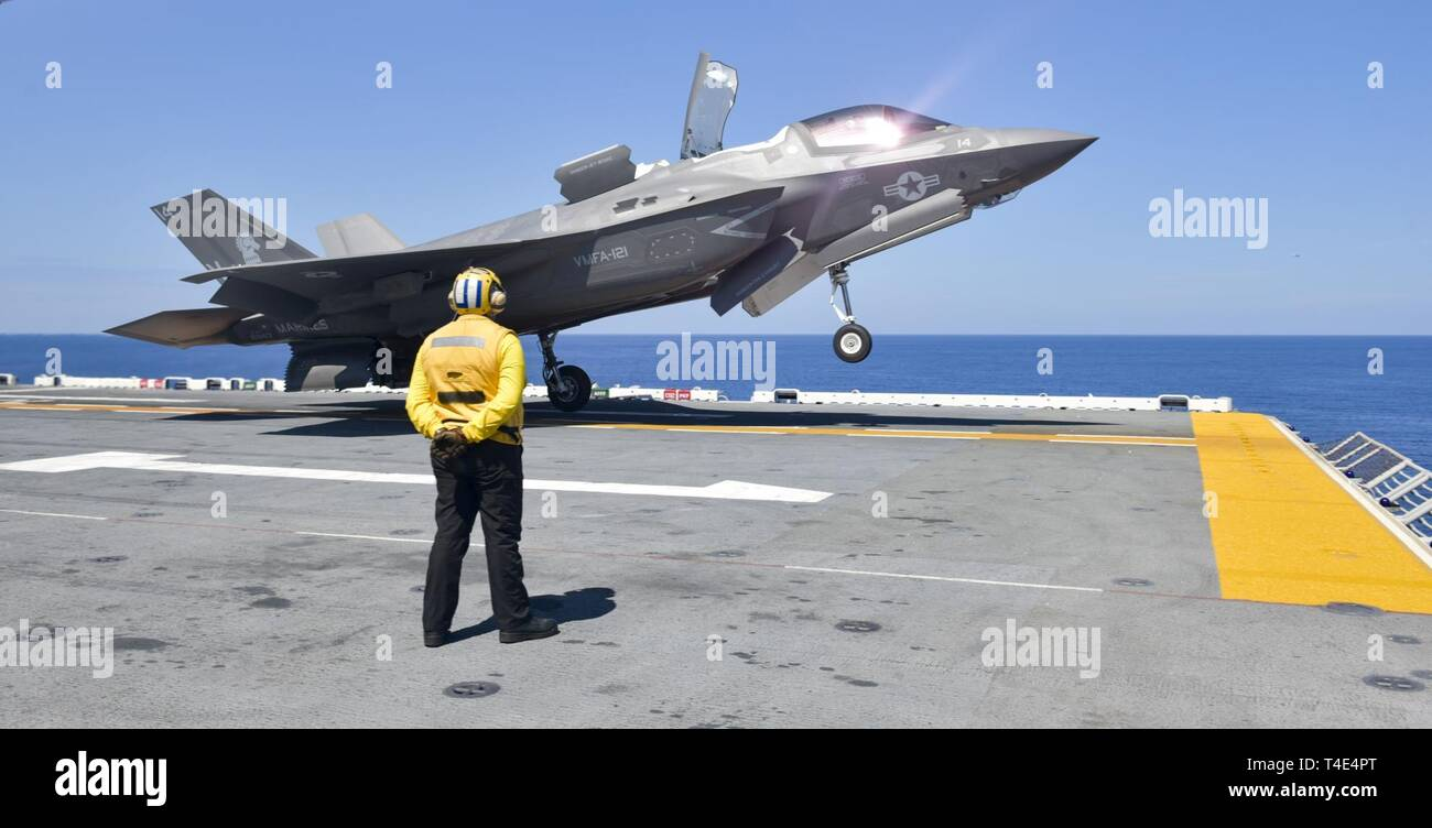 SOUTH CHINA SEA (March 29, 2019) -  An F-35B Lightning II aircraft assigned to Marine Fighter Attack Squadron (VMFA) 121 takes off from the flight deck of the amphibious assault ship USS Wasp (LHD 1). Wasp, flagship of Wasp Amphibious Ready Group, is operating in the Indo-Pacific region to enhance interoperability with partners and serve as a lethal, ready-response force for any type of contingency. - Stock Image