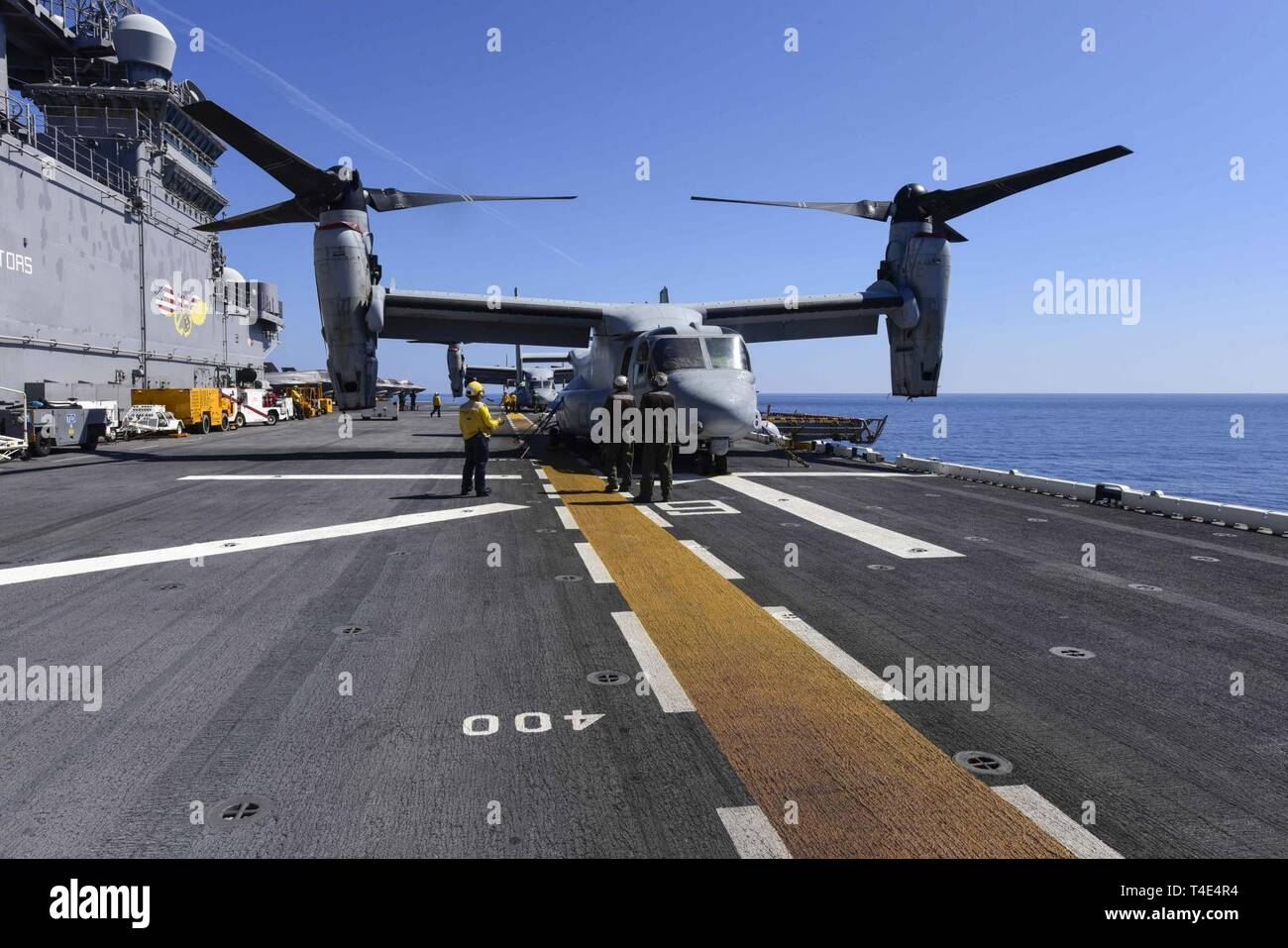 SOUTH CHINA SEA (March 29, 2019) - An MV-22 Osprey, assigned to Marine Medium Tiltrotor Squadron (VMM) 268, is secured to the flight deck of the amphibious assault ship USS Wasp (LHD 1). Wasp, flagship of Wasp Amphibious Ready Group, is operating in the Indo-Pacific region to enhance interoperability with partners and serve as a lethal ready-response force for any type of contingency. - Stock Image