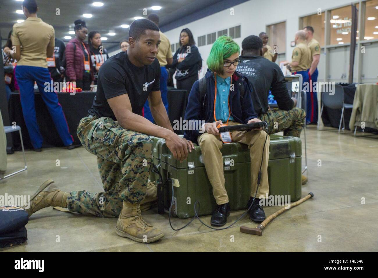 Marine Sgt. Jeremy McBroom, explosive ordnance disposal technician with 2nd EOD Company, 8th Engineer Support Battalion, assists Manny Valle, an eighth grade student at Next Generation Leadership Academy, operate an EOD robot during a National Society of Black Engineers conference STEAMFest in Detroit, March 30, 2019. NSBE is holding its 45th annual national convention consisting of various programs and workshops that are designed to benefit grade school, collegiate, technical, professional and international attendees and the U.S. Marine Corps is a partner organization. Marines partner with or Stock Photo