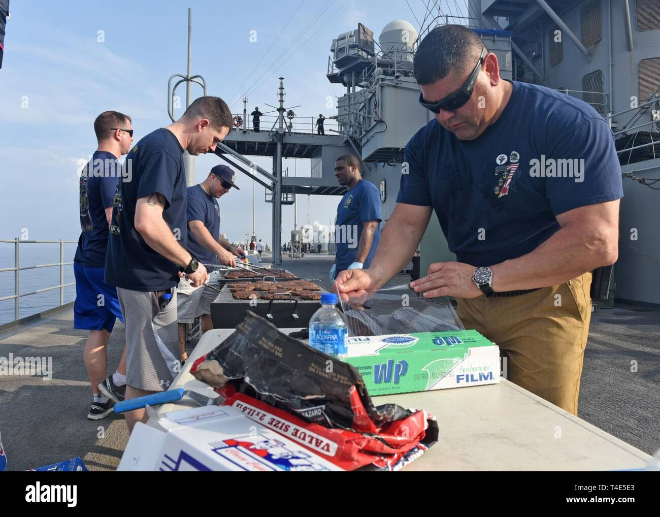 SOUTH CHINA SEA (March 31, 2019) - U.S. 7th Fleet Flagship USS Blue Ridge (LCC 19) chief petty officers prepare food for a steel beach picnic. Blue Ridge is the oldest operational ship in the Navy, and as 7th Fleet command ship, is responsible for fostering relationships within the Indo-Pacific Region. - Stock Image