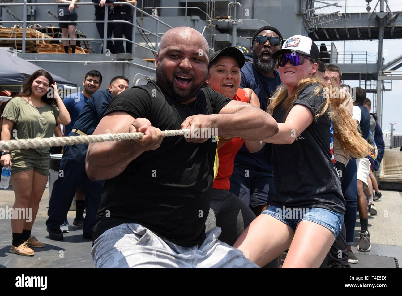 SOUTH CHINA SEA (March 31, 2019) - Sailors attached to U.S. 7th Fleet Flagship USS Blue Ridge (LCC 19) participate in a tug-of-war during a steel beach picnic. Blue Ridge is the oldest operational ship in the Navy, and as 7th Fleet command ship, is responsible for fostering relationships within the Indo-Pacific Region. - Stock Image