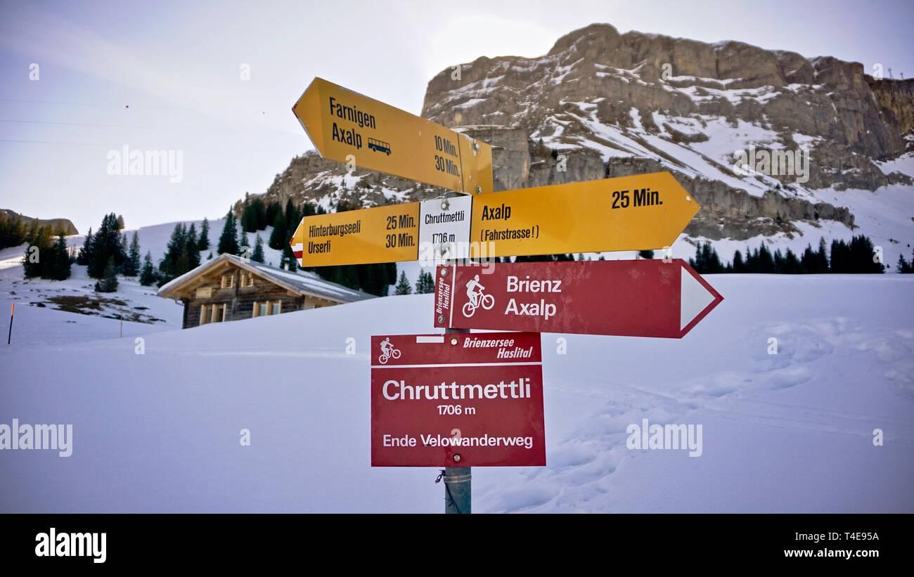 Direction banner on winter hiking trail in Axalp on Brienz, Switzerland, Europe - Stock Image