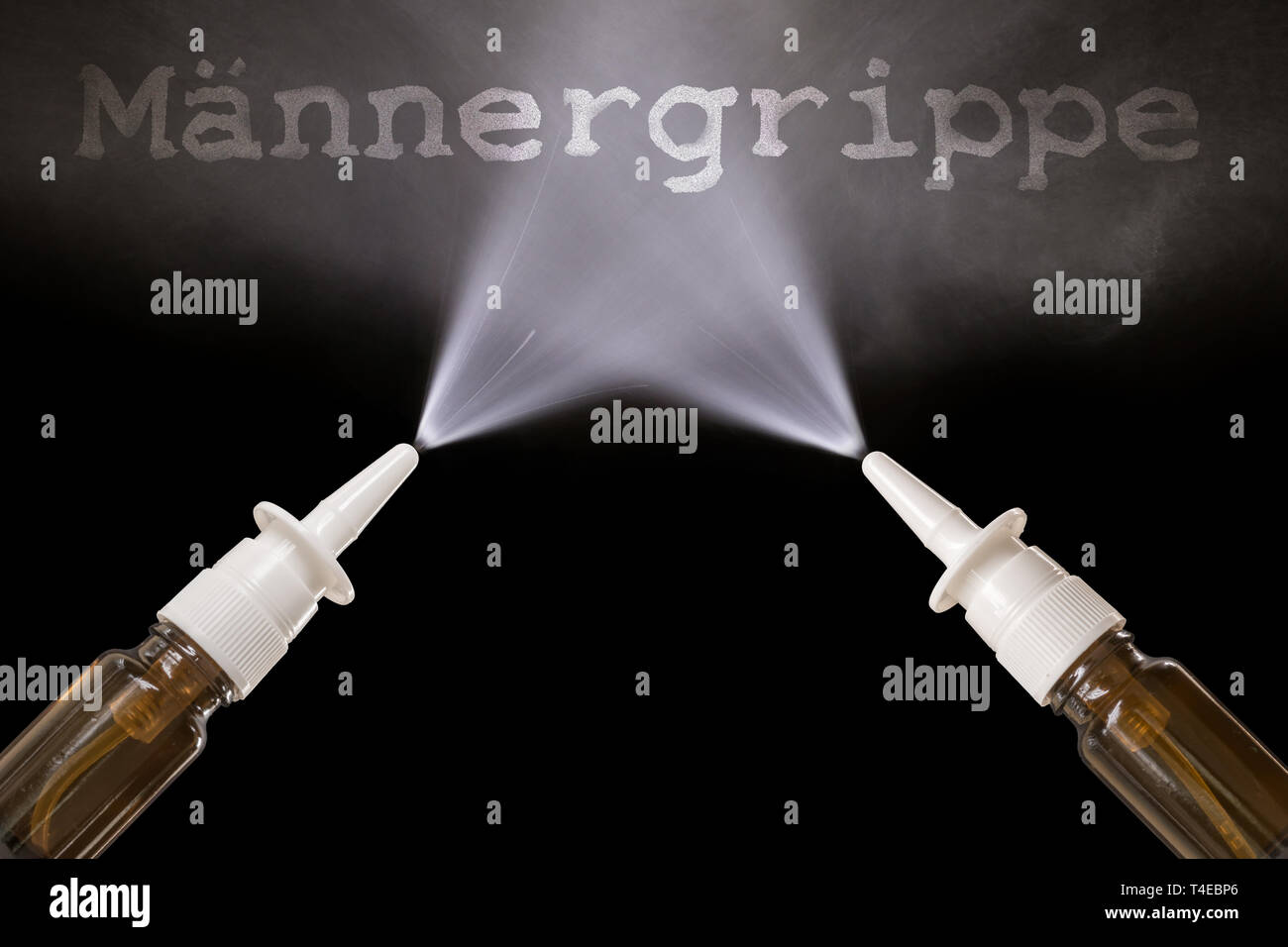 Spraying nasal spray with the headline in German 'Men flu' - Stock Image