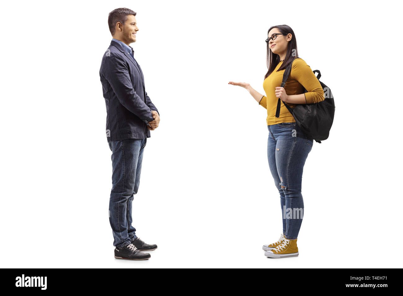 Full length shot of a young man talking with a female student gesturing with hand isolated on white background - Stock Image