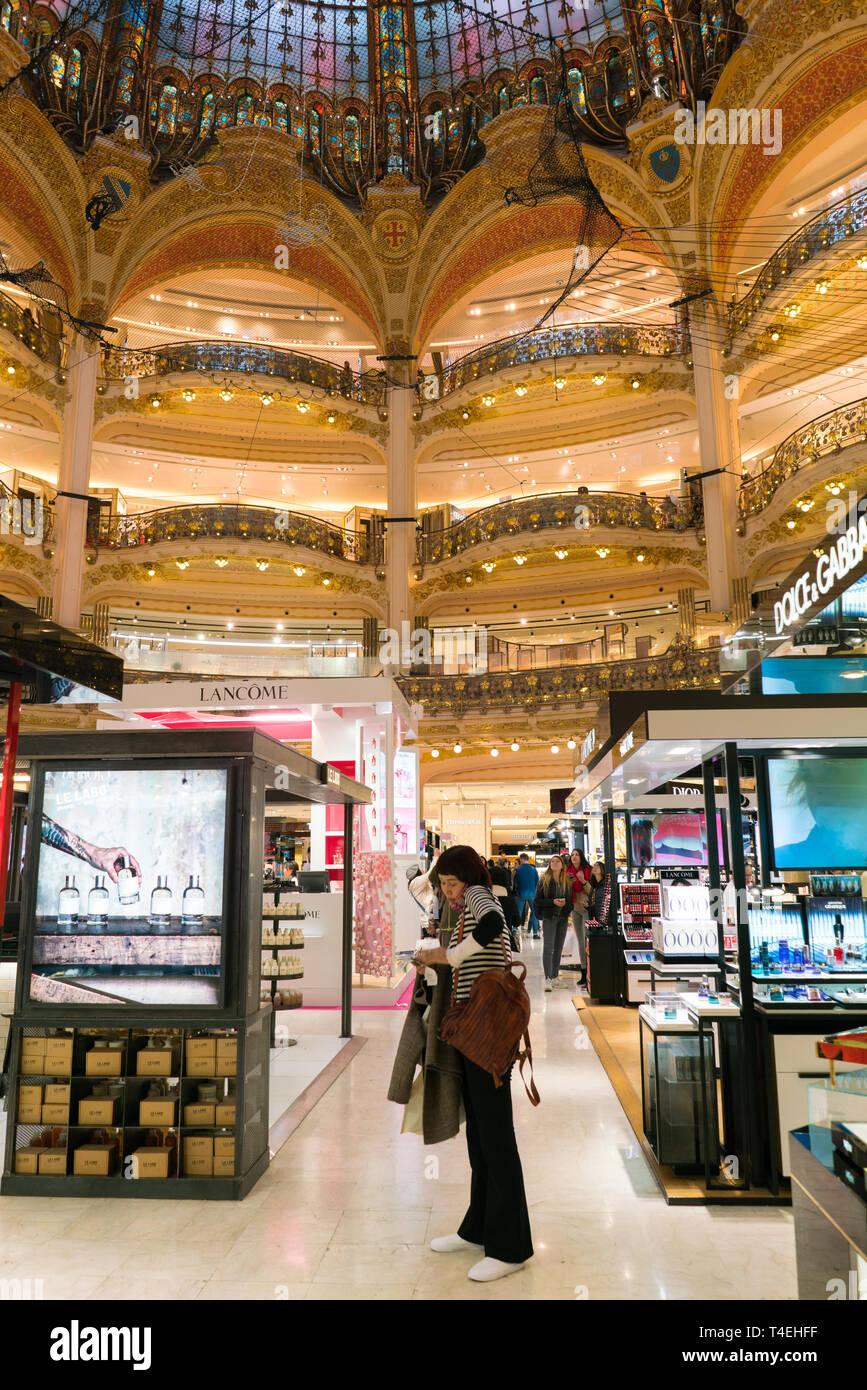 Paris, France - April 3, 2019: Galeries Lafayette interior in Paris. The architect Georges Chedanne designed the store where a Art Nouveau glass and Stock Photo