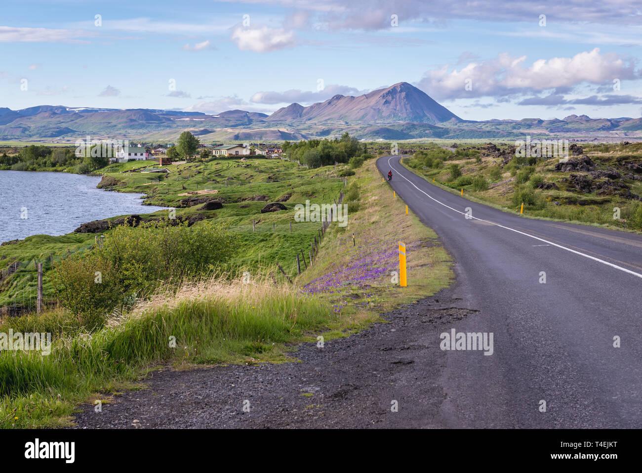Road 848 along Lake Myvatn near Reykjahlid village in Iceland - Stock Image