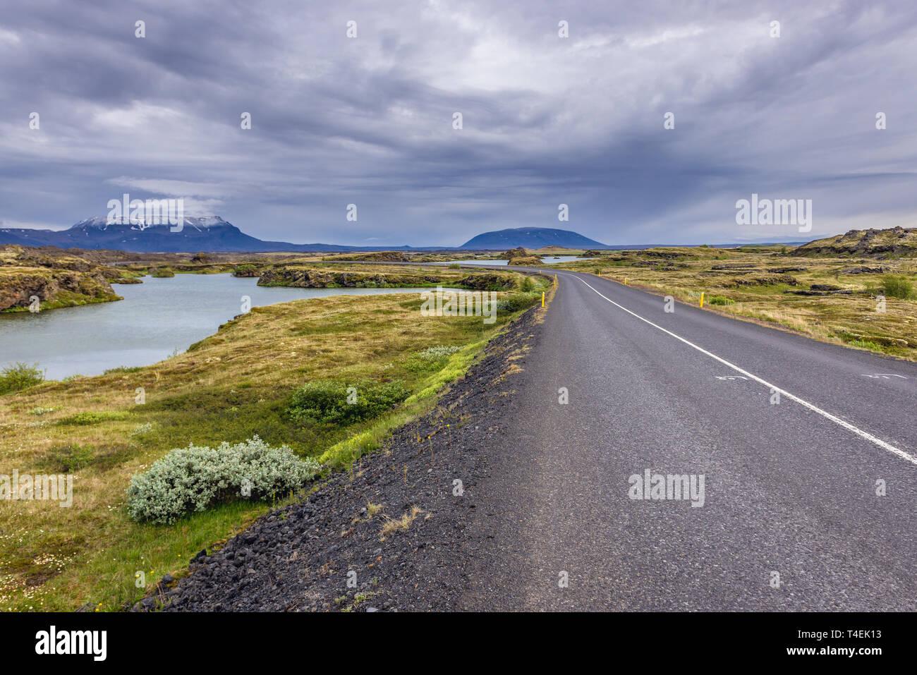 Road 848 along Lake Myvatn near Reykjahlid village in Iceland Stock Photo
