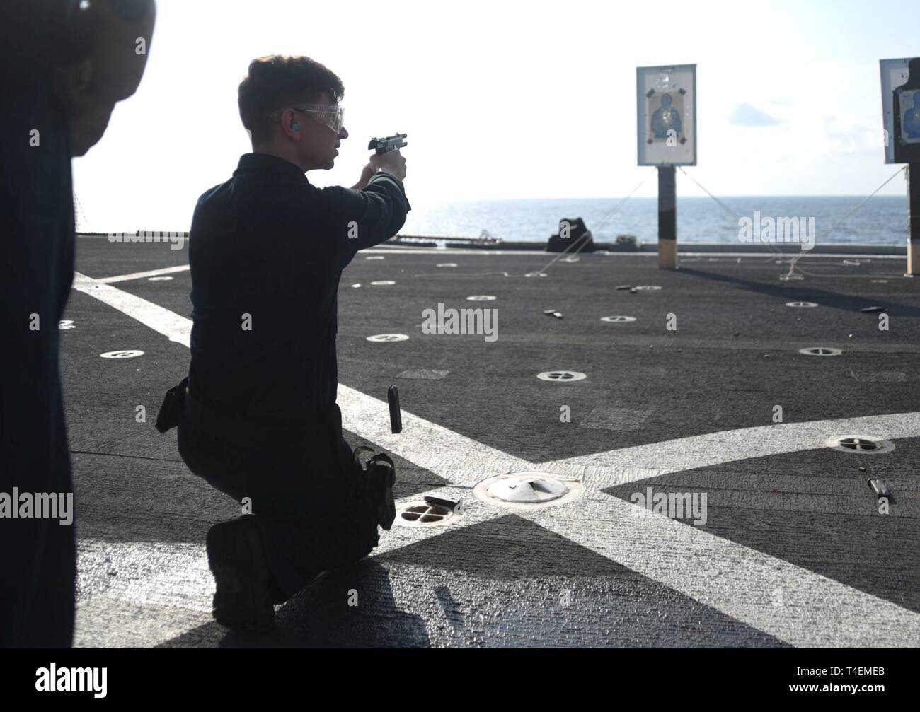 SOUTH CHINA SEA (April 4, 2019) - Mass Communication Specialist 3rd Class Ethan Carter, from Augusta, Ga., unloads an M9 pistol during a gun shoot aboard U.S. 7th Fleet flagship USS Blue Ridge (LCC 19). Blue Ridge is the oldest operational ship in the Navy and, as 7th Fleet command ship, actively works to foster relationships with allies and partners in the Indo-Pacific Region. - Stock Image