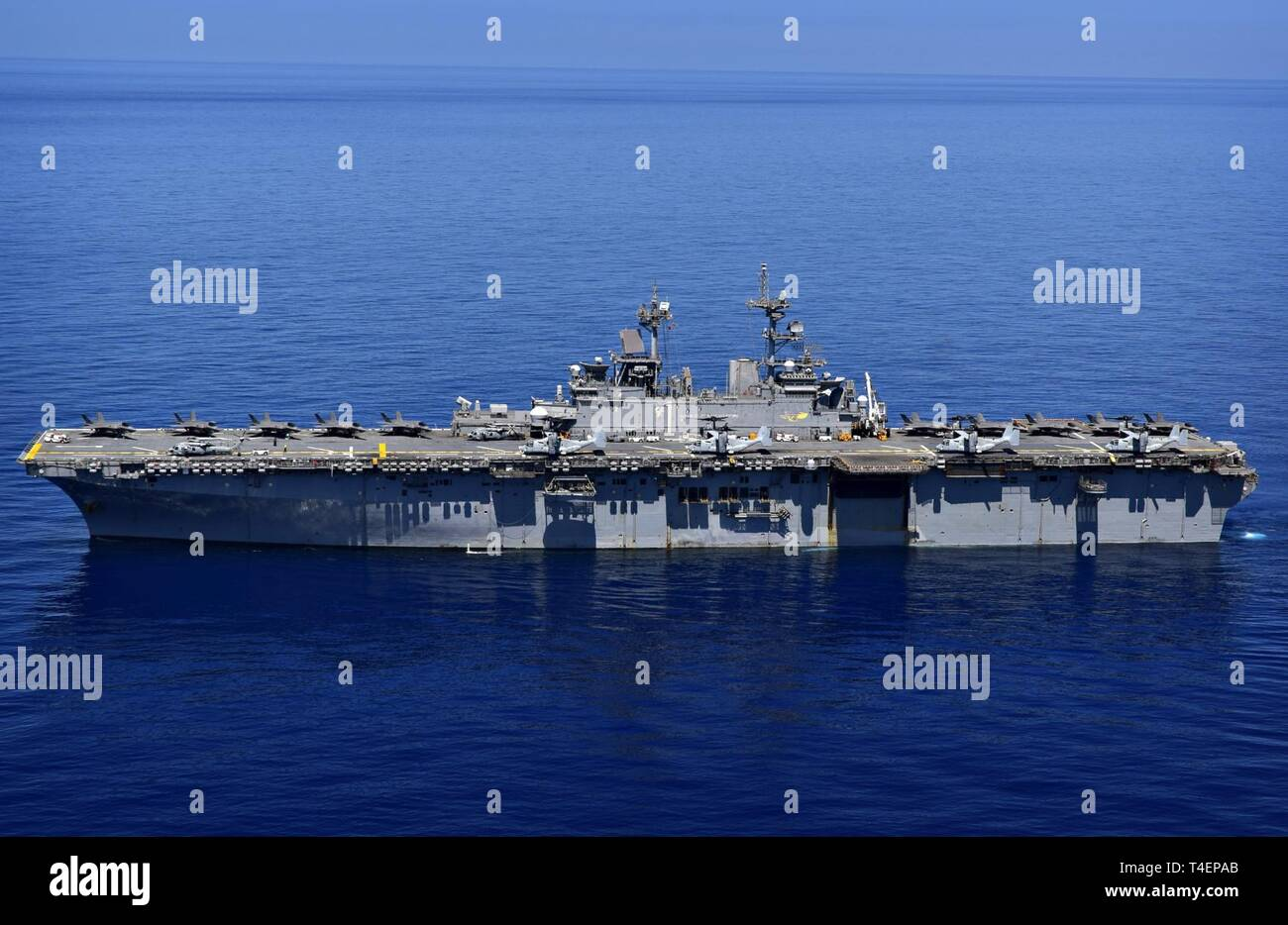 SOUTH CHINA SEA (March 29, 2019) The amphibious assault ship USS Wasp (LHD 1) transits the waters of the South China Sea. Wasp, flagship of Wasp Amphibious Ready Group, is operating in the Indo-Pacific region to enhance interoperability with partners and serve as a lethal, ready-response force for any type of contingency. - Stock Image