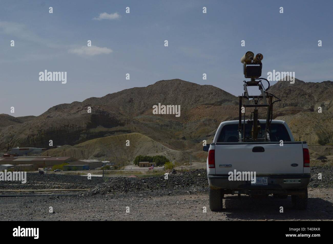 """A Mobile Surveillance Camera parked at """"Monument Two"""" near the Santa Teresa Port of Entry in Sunland Park, N.M., April 3, 2019. The Monument Two MSC is one of 22 along the New Mexico/Mexico border operated by Soldiers assigned to 1-37 Field Artillery Battalion. The Department of Defense has deployed units across the Southwest Border at the request of U.S. Customs and Border Protection and is providing logistical, engineering, and force protection functions. Stock Photo"""