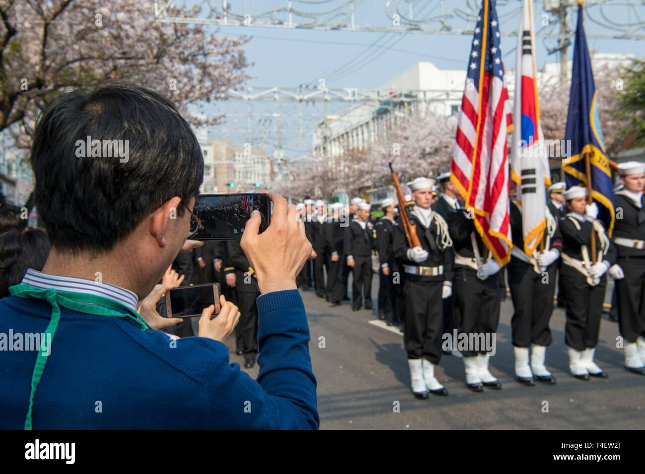 CHINHAE, Republic of Korea (April 05, 2019) Sailors assigned to Commander, Fleet Activities Chinhae (CFAC) march in the 57th annual Jinhae Gunhangje military port festival parade. The festival honors Admiral Yi Sun-sin, a great naval hero of Korea, whose victories still inform the fighting spirit of the ROK Navy. Stock Photo