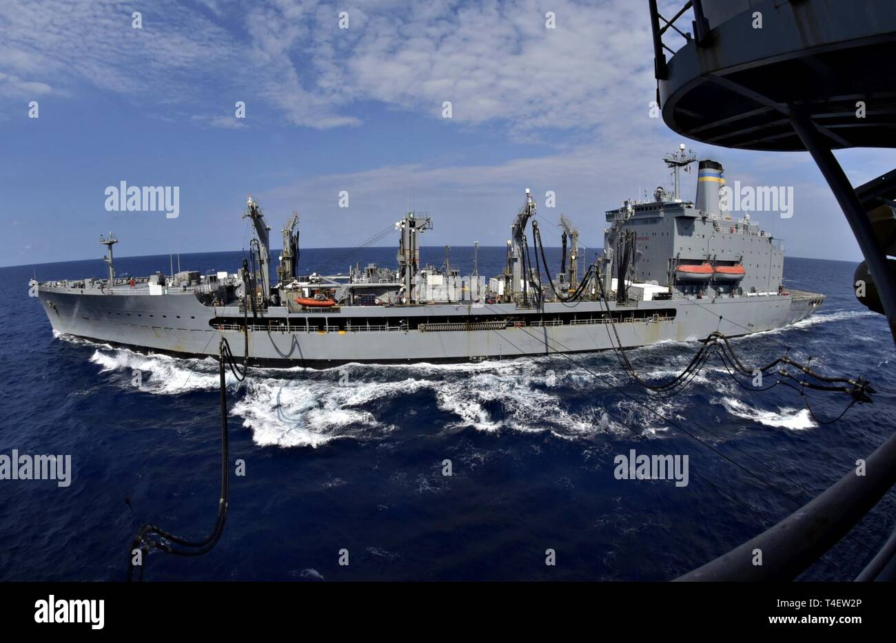 SOUTH CHINA SEA (April 4, 2019) The fleet replenishment oiler USNS Pecos (T-AO 197) and the amphibious assault ship USS Wasp (LHD 1) conduct a replenishment-at-sea during Exercise Balikatan 2019. Exercise Balikatan, in its 35th iteration, is an annual U.S., Philippine military training exercise focused on a variety of missions, including humanitarian assistance and disaster relief, counter-terrorism, and other combined military operations. - Stock Image