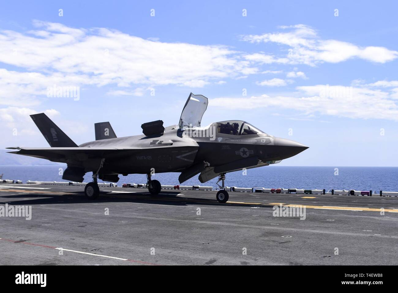 SOUTH CHINA SEA (April 3, 2019) – An F-35B Lightning II aircaft assigned to Marine Fighter Attack Squadron (VMFA) 121 takes off from the flight deck of the amphibious assauly ship USS Wasp (LHD 1) to operate in international airspace off the coast of the Philippines in support of Exercise Balikatan 2019. Exercise Balikatan, in its 35th iteration, is an annual U.S., Philippine military training exercise focused on a variety of missions, including humanitarian assistance and disaster relief, counter-terrorism, and other combined military operations. - Stock Image