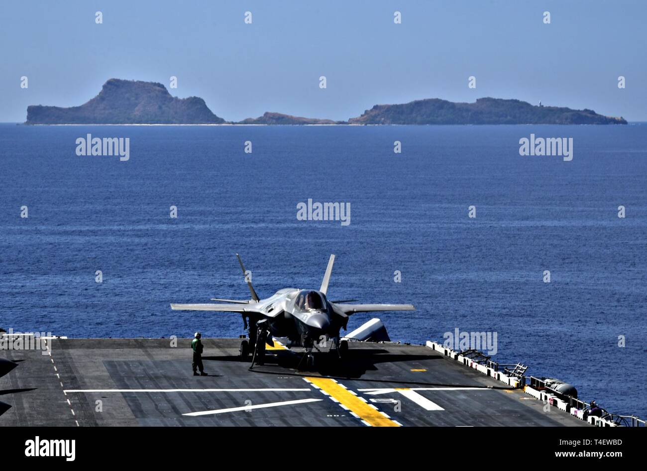 SOUTH CHINA SEA (April 3, 2019) An F-35B Lightning II aircraft, assigned to Marine Fighter Attack Squadron (VMFA) 121, is secured to the flight deck as the amphibious assault ship USS Wasp (LHD 1) operates off the coast of the Philippines in support of Exercise Balikatan 2019. Exercise Balikatan, in its 35th iteration, is an annual U.S., Philippine military training exercise focused on a variety of missions, including humanitarian assistance and disaster relief, counter-terrorism, and other combined military operations. - Stock Image